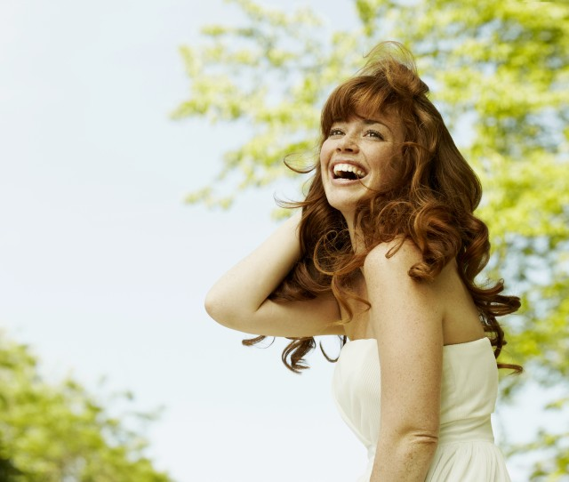 Young woman with long hair, laughing